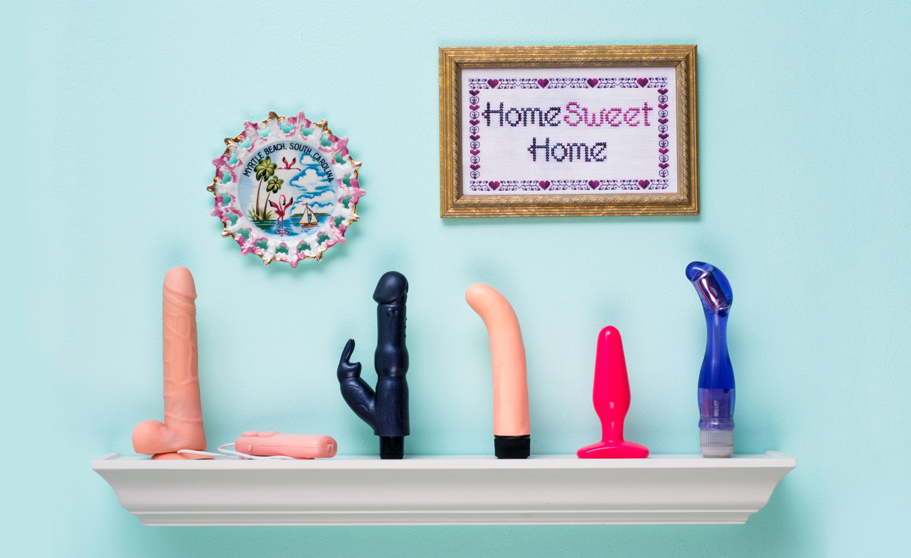 Sex toys on mantel home sweet home