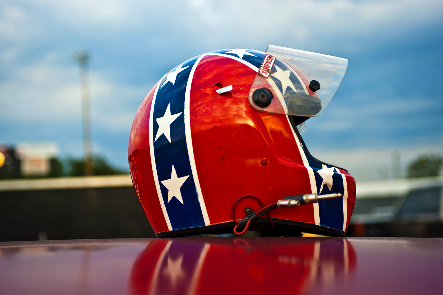 Nascar helmet on car roof at Orange County speedway